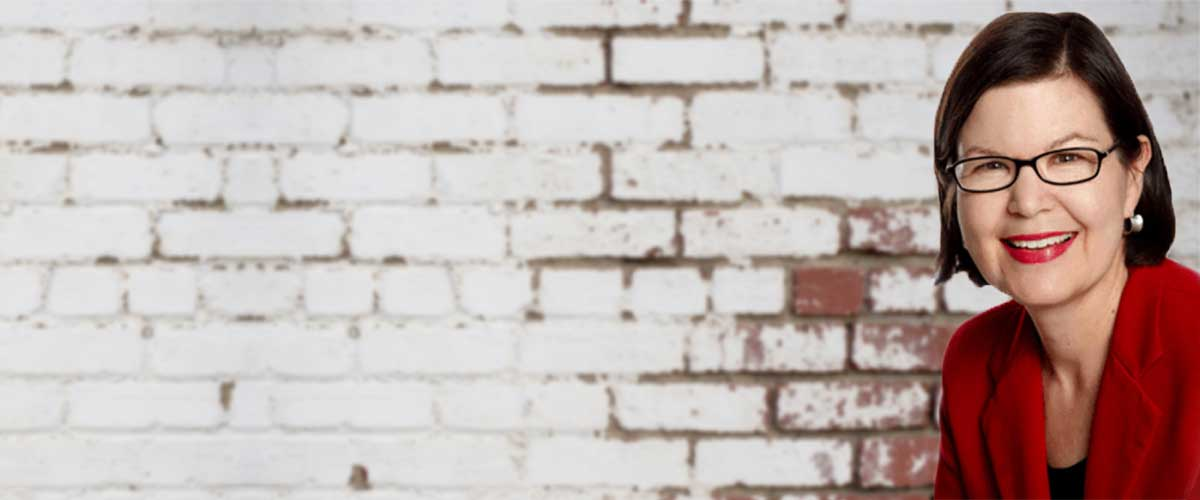 Margaret Marcuson Banner_ white brick background